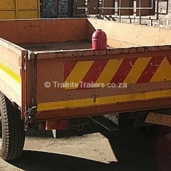 trailer-maintenance-on-red-general-purpose-trailer-before